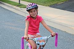 Ava on her bike - BikeSafe IM