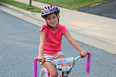 Ava on her bike - BikeSafe IM